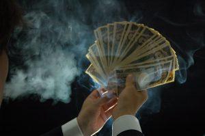 闇金にお金が渡るイメージ